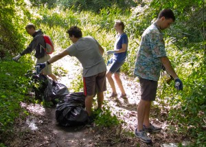 Tufts University students collecting discarded cans from the trailside to be recycled